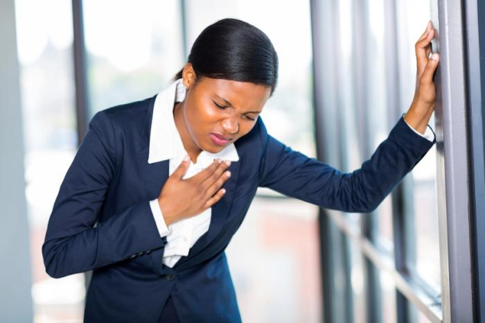 A woman is experiencing chest pain.