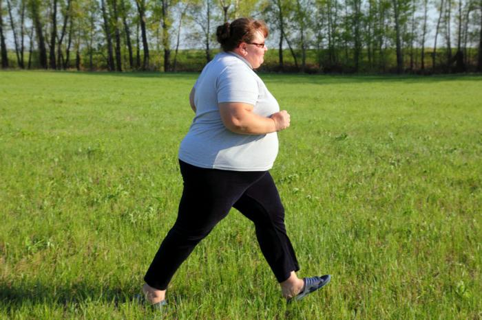 [obese woman exercising]