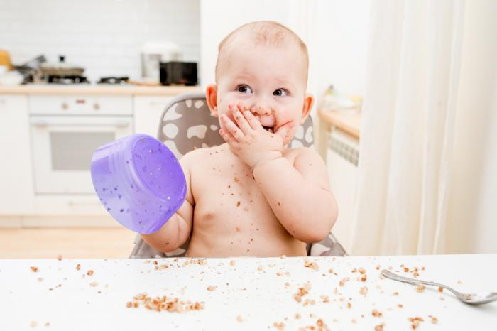 Baby eating at table
