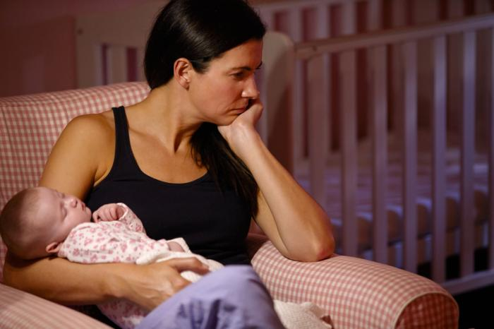 A mother with postpartum depression.