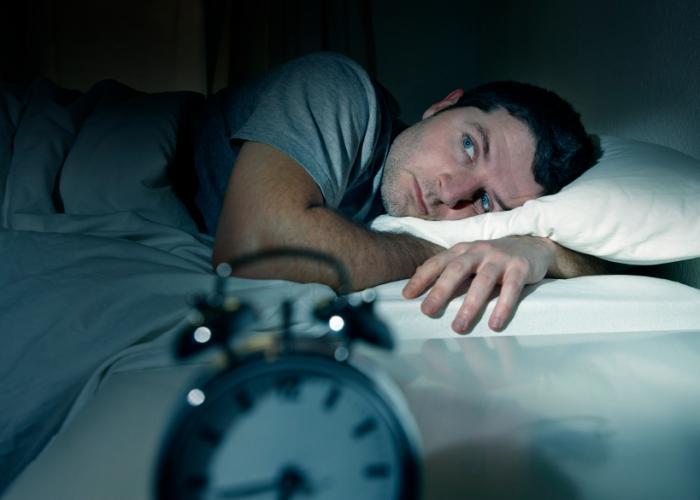 [A man unable to sleep]