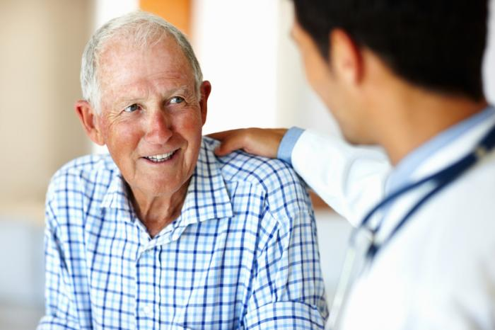 [Old man smiling with doctor]