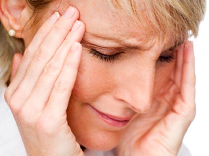 young blond woman having a headache close up